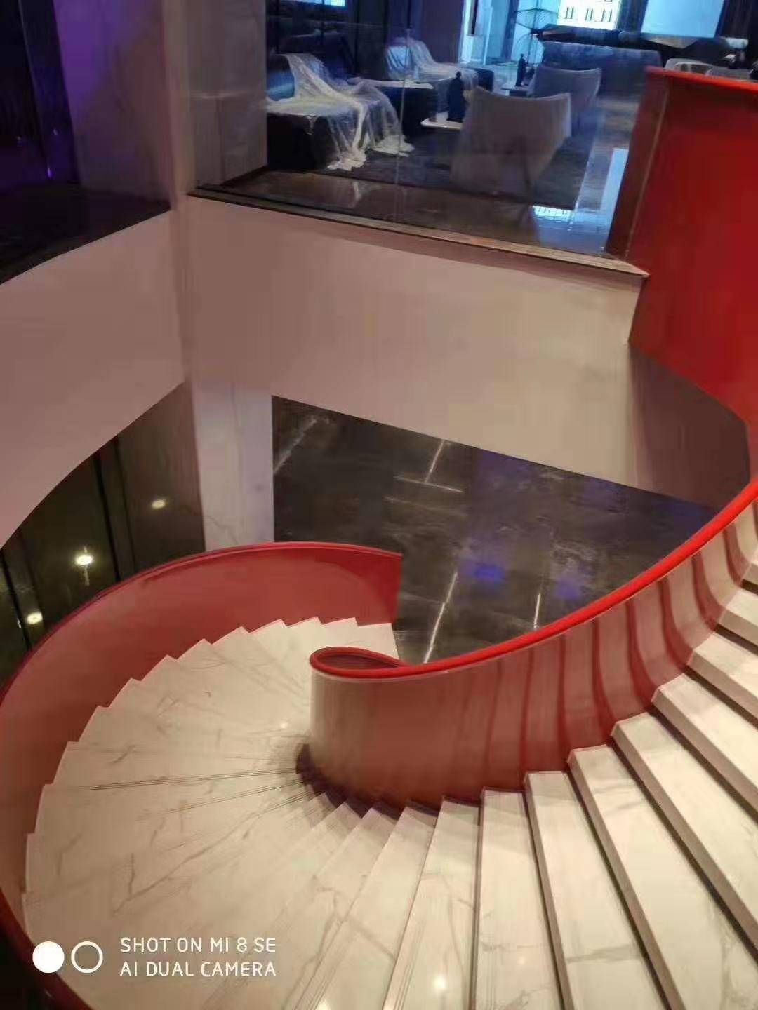 Contemporary double wood curved staircase
