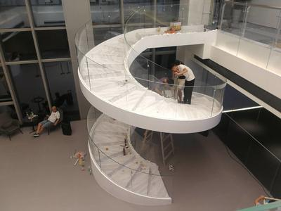 Building modern space saving curved stairs