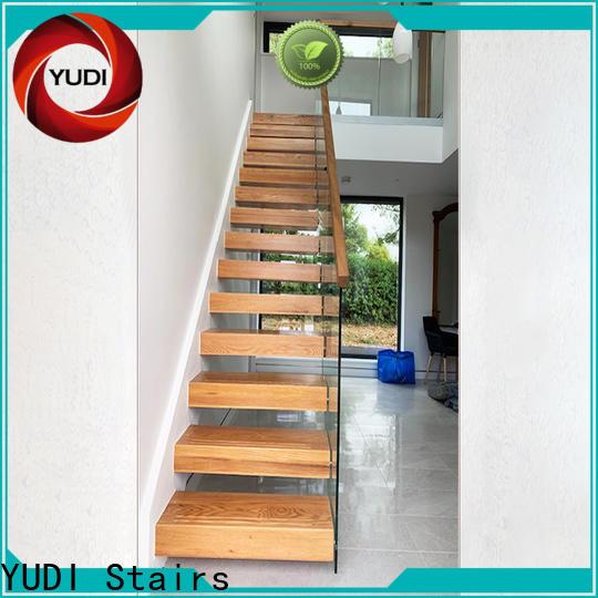Custom floating oak staircase for villa